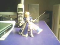 Saber and two swords